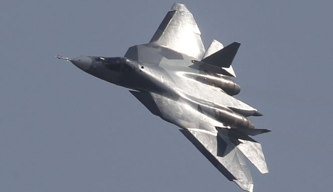 """FILE - In this file photo taken on Wednesday, Aug. 17, 2011, a Russian twin-engine jet fighter T-50 flies over Zhukovsky airfield as it takes part in the MAKS-2011 International Aviation and Space Show, outside Moscow, Russia. Russia's first stealth fighter jet has had to abort takeoff at Moscow's International Aviation and Space Show.The T-50 did not leave the runway and was slowed by a brake parachute. The reason for Sunday's aborted takeoff was not immediately clear. Russian news agencies quoted air show officials as saying only that the reason was """"technical."""" (AP Photo/Mikhail Metzel)"""
