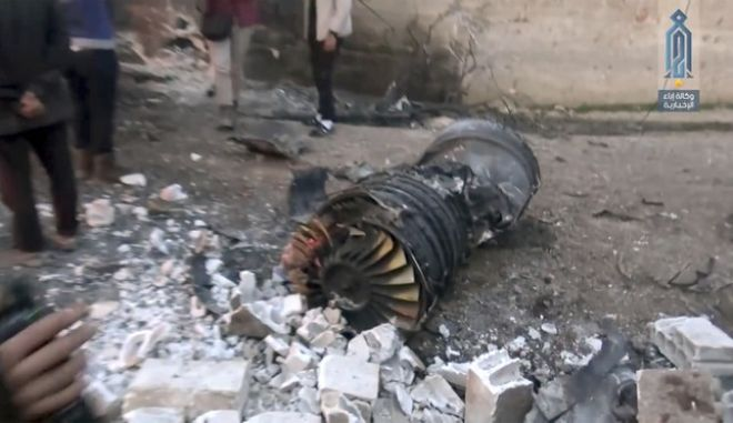 This photo provided by the Ibaa News Agency the media arm of al-Qaidas branch in Syria shows part of a Russian plane that was shot down by rebel fighters over northwest Idlib province in Syria, Saturday, Feb. 3, 2018.  A Russian pilot who ejected from his fighter jet after it was shot down in northwestern Syria on Saturday was killed by militants after he landed alive on the ground and resisted capture by an al-Qaida-linked group, Syrian monitors and a Syrian militant said. Moscow did not confirm the downing of its plane or the killing of a pilot in Syria. The Britain-based Syrian Observatory for Human Rights said the Russian pilot was dead but had no further details.  (Ibaa News Agency via AP)