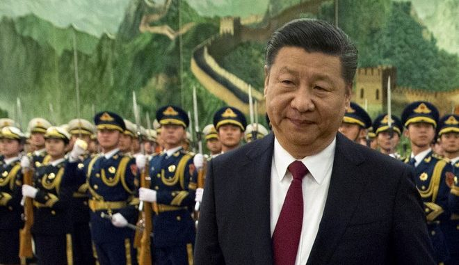 FILE - In this Tuesday, Jan. 9, 2018, file photo, Chinese President Xi Jinping reviews a Chinese honor guard during a welcome ceremony for a visiting dignitary at the Great Hall of the People in Beijing. In a rare public expression of dissent in China, a well-known political commentator and a prominent businesswoman penned open letters urging lawmakers to reject a plan that would allow President Xi Jinping to rule indefinitely. (AP Photo/Mark Schiefelbein, File)