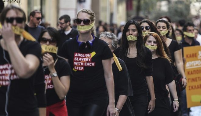 People attend an A21 global anti-human trafficking campaign entitled Walk For Freedom in Athens, on October 14, 2017
