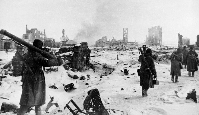 Soviet troops trudge through snow amid the ruins of Stalingrad during the bitter fighting in the city, Jan. 31, 1943. (AP Photo/Novosti)