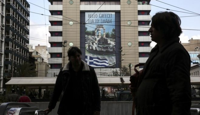 Commuters make their way around central Omonoia square in Athens, Tuesday, Feb. 21, 2017. Greece and its European creditors agreed Monday to resume talks on what economic reforms the country must make next in order to get the money it needs to avoid bankruptcy and a potential exit from the euro this summer. (AP Photo/Yorgos Karahalis)