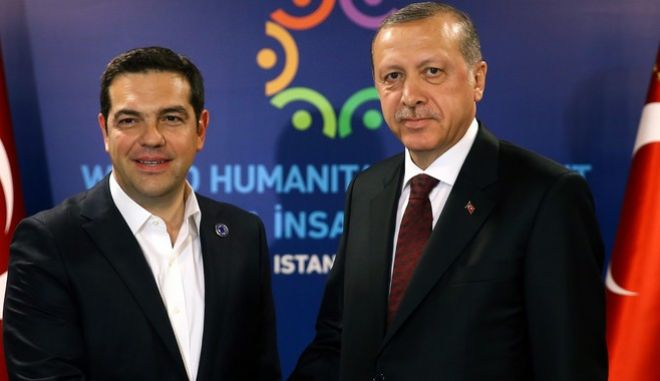 Turkey's President Recep Tayyip Erdogan, right, shakes hands with Greek Prime Minister Alexis Tsipras, prior to their meeting at the World Humanitarian Summit in Istanbul, Monday, May 23, 2016. World leaders and representatives of humanitarian organizations from across the globe converge in Istanbul on May 23-24, 2016 for the first World Humanitarian Summit, focused on how to reform a system many judge broken. (Kayhan Ozer/Pool Photo via AP)