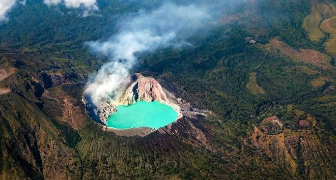 G319JK Aerial photo of active volcano Ijen in East Java - largest highly acidic crater lake in world with turquoise sulphuric water.