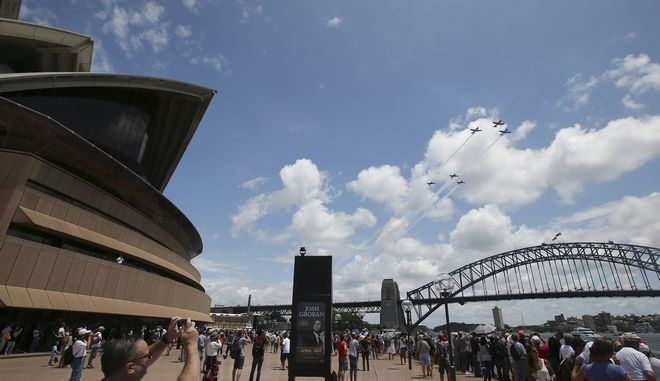 Royal Australian Air Force aircraft fly past the Sydney Harbour Bridge and the Opera House during Australia Day celebrations in Sydney Tuesday, Jan. 26, 2016. Australia Day is the anniversary of the arrival and landing of the first fleet of convict ships from Britain, and the raising of the Union Jack at Sydney Cove by Capt. Arthur Phillip, on Jan 26, 1788. (AP Photo/Rob Griffith)