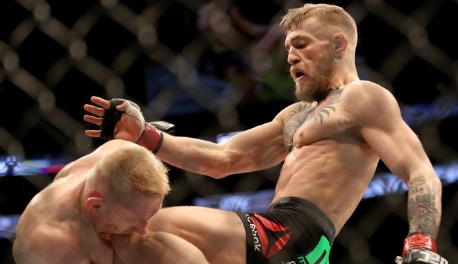 FILE - This Jan. 18, 2015, file photo, Conor McGregor, of Ireland, right, lands a knee against Dennis Siver, of Germany, during their featherweight fight at UFC Fight Night, in Boston. McGregor's heavy hands are only one reason he's getting a featherweight title shot in just his sixth UFC fight. The Irish brawler's outlandish personality has captivated the sport, but he realizes his tough talk will fall flat if he doesn't beat late replacement Chad Mendes at UFC 189 in Las Vegas on Saturday, July 11. (AP Photo/Gregory Payan,File)