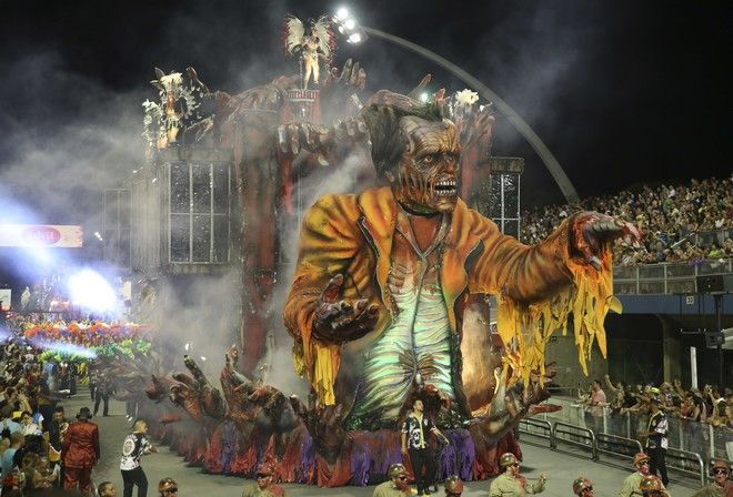Dancers from the Independente samba school perform on a float during a carnival parade in Sao Paulo, Brazil, Friday, Feb. 9, 2018. (AP Photo/Andre Penner)
