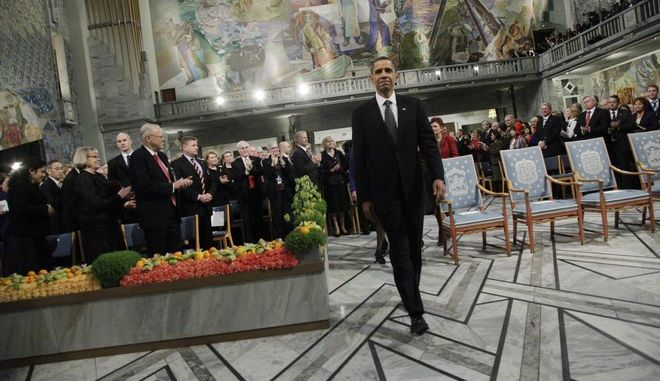 President and Nobel Peace Prize laureate Barack Obama enters the Nobel Peace Prize ceremony at City Hall  in Oslo, Thursday, Dec. 10, 2009. (AP Photo/John McConnico)