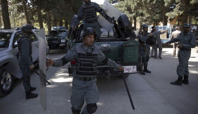 """Anti-riot police soldiers arrive, during a demonstration against the U.S. government, in Kabul, Afghanistan, Sunday, April 16, 2017. Demonstrators protested against """"testing"""" the """"Mother of all bombs"""" on an """"empty"""" village in eastern Nangarhar province, on Thursday, April 13. (AP Photo/Massoud Hossaini)"""