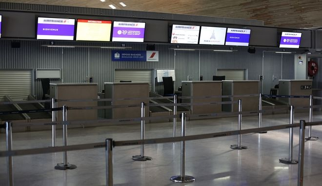 """Air France registration desks are deserted at the Roissy Charles de Gaulle airport, in Roissy, north of Paris, Thursday, Feb.22, 2018. Hundreds of angry Air France staff are demonstrating at the French airlines' headquarters in northern Paris amid a strike over pay that has grounded flights. Air France said that half of its long-haul flights departing from Paris will not operate Thursday and encouraged customers with a Thursday flight reservation to change their ticket """"at no extra cost."""" (AP Photo/Thibault Camus)"""