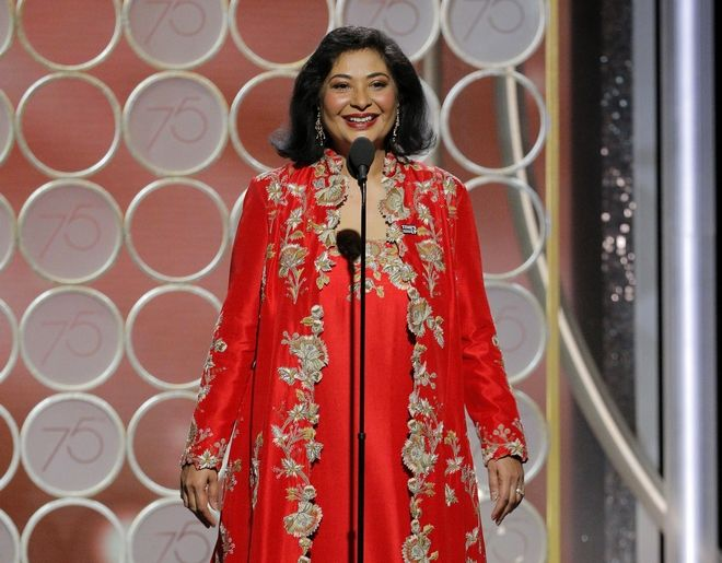 This image released by NBC shows Hollywood Foreign Press Association President Meher Tatna at the 75th Annual Golden Globe Awards in Beverly Hills, Calif., on Sunday, Jan. 7, 2018. (Paul Drinkwater/NBC via AP)