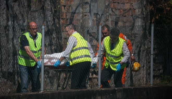 A victim is carried on a stretcher after a train derailed in O Porrino, northern Spain, Friday, Sept 9, 2016. A passenger train traveling from Vigo to Porto, in neighboring Portugal, derailed Friday in Spain's northwestern Galicia region, killing three people and injuring several others, authorities said. (AP Photo/Lalo R. Villar)
