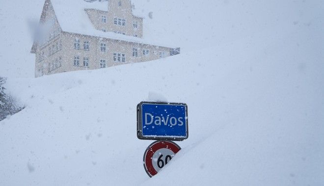 The town sign stands in the snow at the entrance to Davos, Switzerland, Monday, Jan. 22, 2018. The 48th annual meeting of the World Economic Forum, WEF, takes place in the city and brings together entrepreneurs, scientists, chief executives and political leaders from Jan. 23 to 26. (AP Photo/David Keyton)