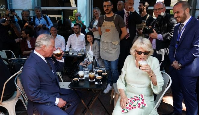 Prince of Wales Charles and his wife Duchess of Cornwall Camilla Parker Bowles walk in the center of Athens during their three days official visit in Greece