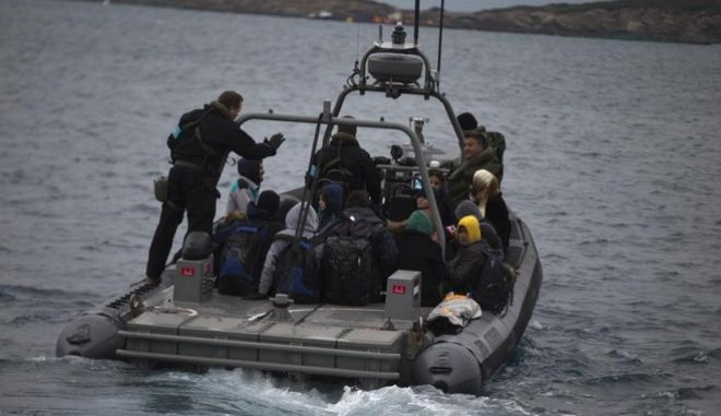 In this photo taken on Wednesday, Jan. 20, 2016, a Frontex speedboat with a Dutch crew transfers about 25 refugees and migrants from the deserted Greek island of Pasas to the nearby island of Oinousses, near Chios island. Chios, second in the number of arrivals after Lesbos, has three coast guard vessels as well as Frontex reinforcements. Hour after hour, by night and by day, Greek coast guard patrol and lifeboats, reinforced by vessels from the European Unions border agency Frontex, ply the waters of the eastern Aegean Sea along the frontier with Turkey, on the lookout for people being smuggled onto the shores of Greek islands - the frontline of Europes massive refugee crisis.  (AP Photo/Petros Giannakouris)