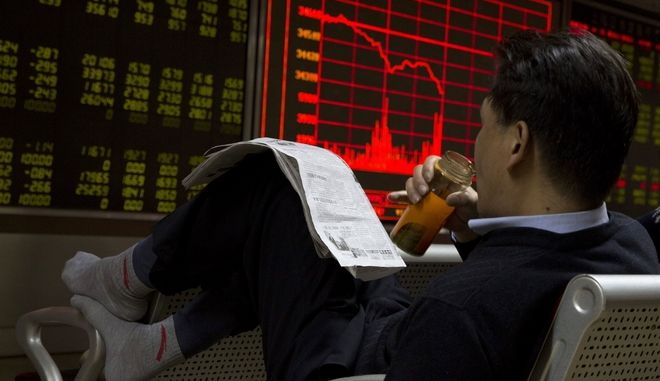 Chinese investors react near a board showing the Shanghai Stock Exchange Composite Index at a brokerage in Beijing, China, Wednesday, Nov. 9, 2016. The rising prospect of a Trump presidency jolted markets around the world Wednesday, sending Dow futures and Asian stock prices sharply lower as investors panicked over uncertainties on trade, immigration and geopolitical tensions. (AP Photo/Ng Han Guan)