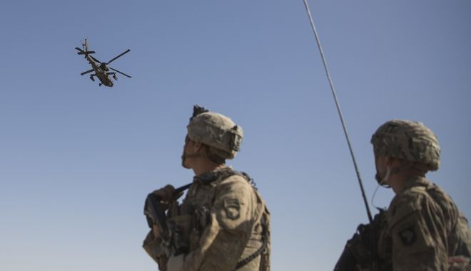 This June 10, 2017 photo released by the U.S. Marine Corpsshows an AH-64 Apache attack helicopter provides security from above while CH-47 Chinooks drop off supplies to U.S. Soldiers with Task Force Iron at Bost Airfield, Afghanistan. Sixteen years into its longest war, the United States is sending another 4,000 troops to Afghanistan in an attempt to turn around a conflict characterized by some of the worst violence since the Taliban were ousted in 2001. They are also facing the emergence of an Islamic State group affiliate and an emboldened Taliban, who by Washingtons own watchdogs assessment now control nearly half of Afghanistan. (U.S. Marine Corps photo by Sgt. Justin T. Updegraff, Operation Resolute Support via AP)