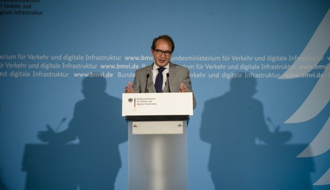 Alexander Dobrindt, German Minister of Transport and Digital Infrastructure, briefs the media during a news conference at his ministry in Berlin, Thursday, July 27, 2017. (AP Photo/Markus Schreiber)