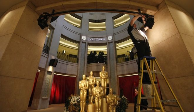 The lights are set to illuminate Oscar statues at the entrance to the Kodak Theatre as preparation continues for the 84th Academy Awards in Los Angeles on Sunday, Feb. 26, 2012.  The Oscars will be held later in the day. (AP Photo/Amy Sancetta)