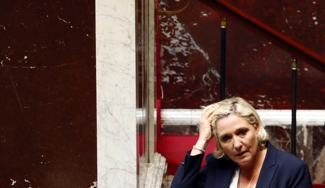 French far-right leader Marine Le Pen arrives at the first session of French National Assembly after the recent presidential and legislative elections, in Paris, Tuesday, June 27, 2017. France's newly elected lawmakers, most of them from President Emmanuel Macron's centrist party, are gathering their first parliament session. (AP Photo/Francois Mori)