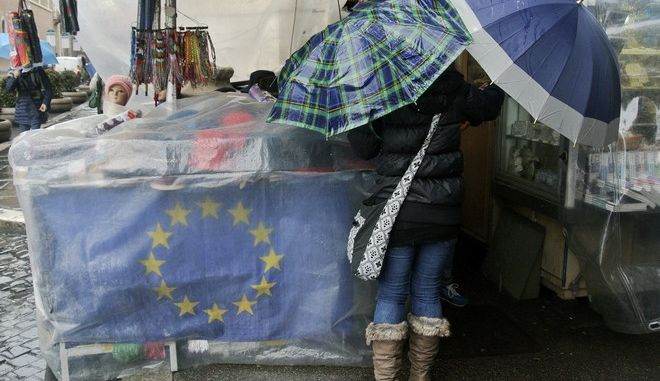 The EU flag wrapped by a plastic sheet, adorns a souvenir stall in downtown Rome, Thursday, Feb. 5, 2015. The European Union's economic forecast predicts that the 19-nation eurozone economy is likely to grow slightly better than anticipated this year, a sign of welcome news as Greece's debt woes weigh on economic confidence. The EU's winter forecast released Thursday says that eurozone growth will rise to 1.3 percent in 2015, up from 1.1 percent predicted in November. The growth rate in powerhouses France and Italy, both struggling with large deficits, is set to rise to 1.0 percent and 0.6 percent respectively. (AP Photo/Gregorio Borgia)