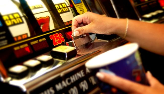 Hands playing slot machine