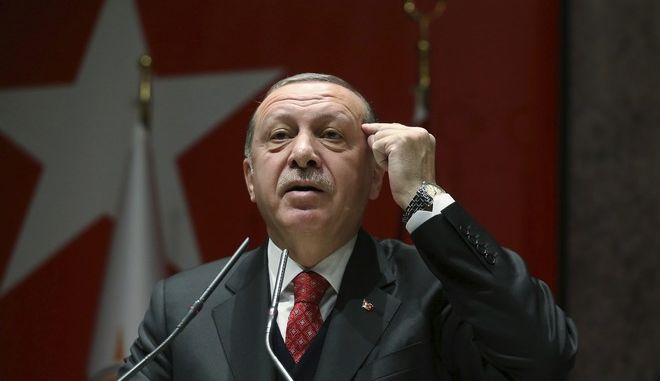 "Turkey's President Recep Tayyip Erdogan addresses to his ruling party's provincial leaders in Ankara, Turkey, Friday, Nov. 17, 2017.  Erdogan says Turkey withdrew 40 soldiers from a NATO military exercise in Norway, after the country's founding leader Mustafa Kemal Ataturk and Erdogan himself were allegedly depicted as ""enemies.""  (Presidential Press Service, pool photo via AP)"