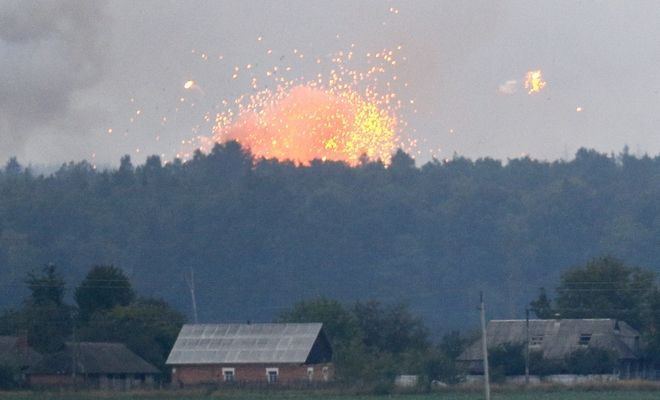 A powerful explosion is seen in the ammunition depot at a military base in Kalynivka, west of Kiev, Ukraine, early Wednesday, Sept. 27, 2017.  Ukrainian officials say they have evacuated more than 30,000 people after a fire and ammunition explosions broke out Tuesday, at the military base. (AP Photo/Efrem Lukatsky)