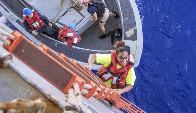 In this Wednesday, Oct. 25, 2017 photo, Tasha Fuiaba, an American mariner who had been sailing for five months on a damaged sailboat, climbs the accommodation ladder to board the amphibious dock landing ship USS Ashland after the Navy ship rescued two Honolulu women and their dogs after being lost at sea for several months while trying to sail from Hawaii to Tahiti. The U.S. Navy rescued the women on Wednesday after a Taiwanese fishing vessel spotted them about 900 miles southeast of Japan on Tuesday and alerted the U.S. Coast Guard. The women, identified by the Navy as Jennifer Appel and Tasha Fuiaba, lost their engine in bad weather in late May, but believed they could still reach Tahiti. (Mass Communication Specialist 3rd Class Jonathan Clay/U.S. Navy via AP)