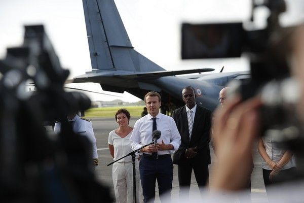 France's President Emmanuel Macron addresses the media upon his arrival in Pointe-a-Pitre, Guadeloupe island, the first step of his visit to French Caribbean islands, Tuesday, Sept. 12, 2017. (AP Photo/Christophe Ena, Pool)