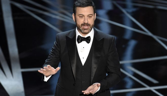 FILE - In this Feb. 26, 2017, file photo, host Jimmy Kimmel appears at the Oscars in Los Angeles. Kimmel accepted U.S. Senate candidate Roy Moore's invitation to meet him in Alabama on Nov. 30, 2017, after Kimmel sent a comedian to heckle Moore during a talk he was giving at a church the night before. (Photo by Chris Pizzello/Invision/AP, File)