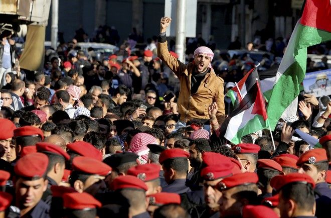 Jordanian protesters shout slogans during a protest in Amman, Jordan after Donald Trump's decision to recognize Jerusalem as the capital of Israel, on Friday, Dec. 8, 2017. (AP Photo/Raad Adayleh)