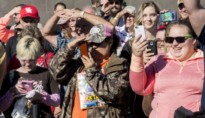 IMAGE DISTRIBUTED FOR DICK'S SPORTING GOODS - Fans take photos of Phil Robertson, reality television star from the Duck Dynasty series, during a recent store appearance at the new DICKS Sporting Goods Grand Opening Celebration at the Baybrook Mall in Friendswood, TX on Friday, October 21, 2016.  (Photo by Scott Dalton/Invision for DICK'S Sporting Goods/AP Images)