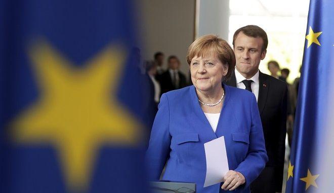 Η Γερμανίδα καγκελάριος Άνγκελα Μέρκελ και ο Γάλλος πρόεδρος Εμανουέλ Μακρόν στο Βερολίνο