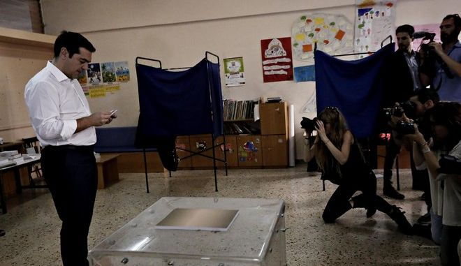 The greek Prime Minister Alexis Tsipras, votes for the greek referendum, in Kipseli, Athens, July 5, 2015 /         ,  , , 5 , 2015