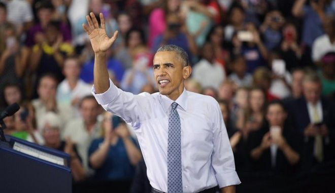 ELKHART, IN - JUNE 01:  President Barack Obama waves to the crowd at Concord Community High School as he leaves after speaking on June 1, 2016 in Elkhart, Indiana. Obama returned to the school, which he visited more than seven years ago, to highlight economic progress made during his administration.  (Photo by Scott Olson/Getty Images)