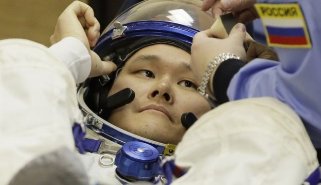 Japanese astronaut Norishige Kanai, a member of the main crew to the International Space Station (ISS), looks on during inspecting his space suit prior to the launch of Soyuz-FG rocket at the Russian leased Baikonur cosmodrome, Kazakhstan, Sunday, Dec. 17, 2017. (AP Photo/Dmitri Lovetsky, Pool)