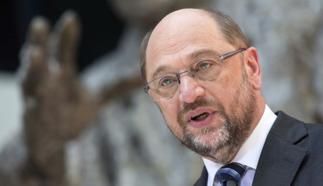 Social Democratic Party chairman Martin Schulz, speaks at a news conference in Berlin, Thursday, June 1, 2017.  Schulz, the former European Parliament president who is hoping to unseat Merkel in Germany's upcoming general election, said he hoped US president Donald Trump would think better of withdrawing from the climate accord. If the U.S. does leave, he said, the Europe Union should seek ways to balance out the economic advantage that U.S. companies might have from the absence of climate regulations. (Bernd von Jutrczenka/dpa via AP)