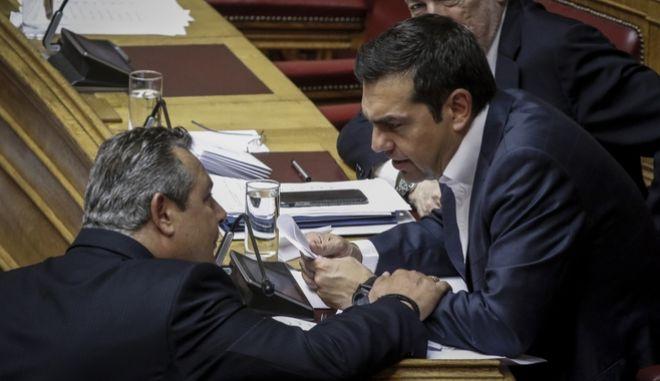 Ο πρωθυπουργός Αλέξης Τσίπρας και ο κυβερνητικός εταίρος Πάνος Καμμένος