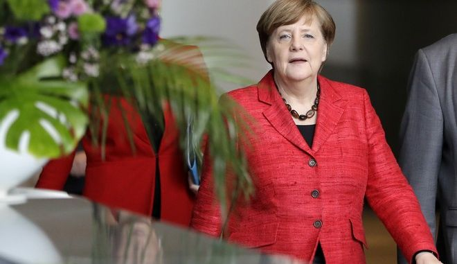 German Chancellor Angela Merkel arrivers for a meeting with people caring in refugee reliefs from all over Germany in Berlin, Germany, Friday, April 7, 2017. (AP Photo/Michael Sohn)