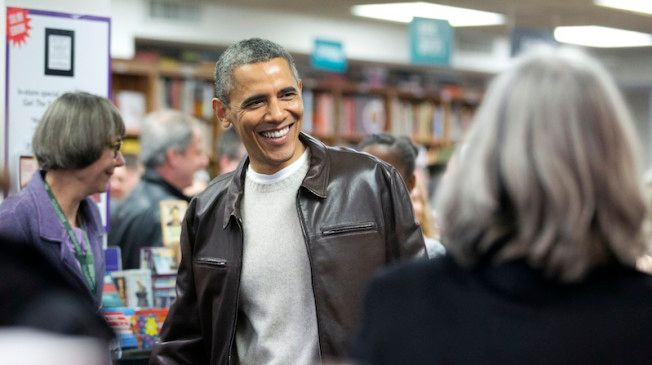 President Barack Obama greets shoppers as he shops at the local bookstore Politics and Prose in northwest Washington, Saturday, Nov. 30, 2013.  (AP Photo/Manuel Balce Ceneta)