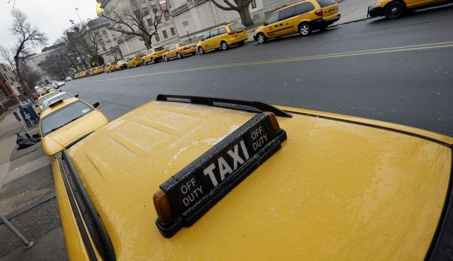 FILE - In this Feb. 9, 2015 file photo, taxi cabs line the street outside the State House in Trenton, N.J.  Lawmakers are betting they can strike the right balance with new legislation aimed at making ridesharing services or transportation networking companies like Uber and Lyft safer. But many are skeptical, including the firms themselves. (AP Photo/Mel Evans)