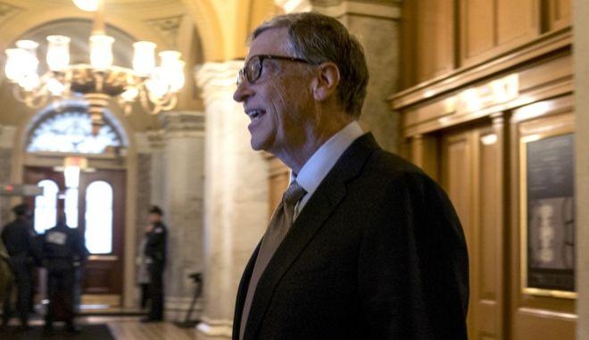 Bill Gates walks though the halls of the Capitol Building in Washington, Thursday morning, Dec. 7, 2017. (AP Photo/Andrew Harnik)