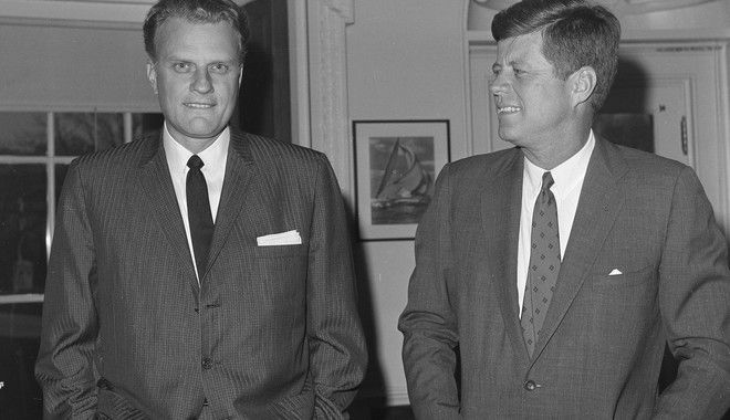 Evangelist Billy Graham, left, talks with President John F. Kennedy during a call at the President's White House office, Dec. 12, 1961.  (AP Photo)
