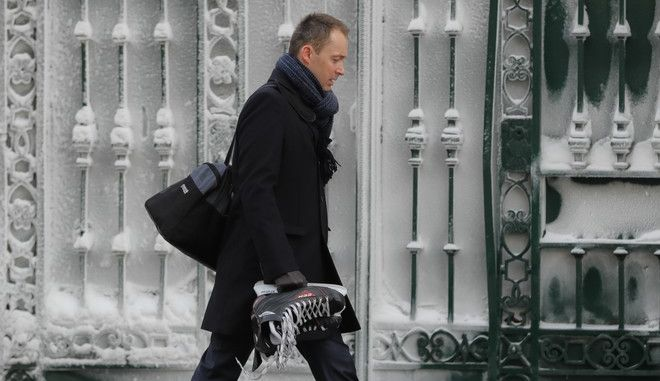 A man walks holds ice skates as temperatures dropped below minus 20 degrees Centigrade ( minus 4 Fahrenheit) in Bucharest, Romania, Tuesday, Jan. 10, 2017. Romania's Energy Minister Toma Petcu said neighboring Bulgaria had urgently asked for extra electricity, but the request was declined since the cold weather has stretched Romania's power grid and natural gas consumption in Romania could reach an all-time high due to the frigid temperatures. (AP Photo/Vadim Ghirda)