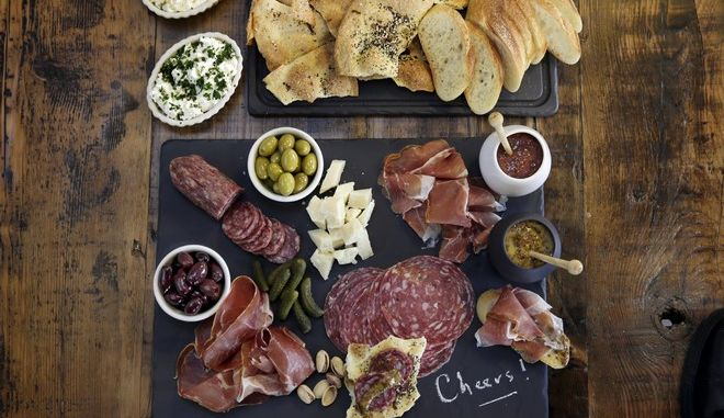 This Sept. 30, 2016 photo shows a charcuterie platter with sweet and sharp mustard at the Institute of Culinary Education in New York. This dish is from a recipe by Elizabeth Karmel. (AP Photo/Richard Drew)