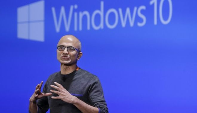 FILE - In this Jan. 21, 2015, file photo, Microsoft CEO Satya Nadella speaks at an event demonstrating the new features of Windows 10 at the company's headquarters in Redmond, Wash. If youre running an older version of Windows, you might suddenly find Microsofts Windows 10 upgrade already downloaded on your machine. The automatic download, beginning the first week of February 2016, is part of Microsofts aggressive push to get Windows 10 on as many devices as possible. (AP Photo/Elaine Thompson, File)