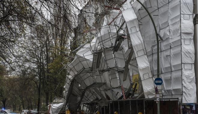 A scaffolding has collapsed  in the district of Schoeneberg in Berlin, Germany, Sunday, Oct. 29, 2017.  High winds struck the country causing flooding and damage in northern and eastern Germany.  (Paul Zinken/dpa via AP)