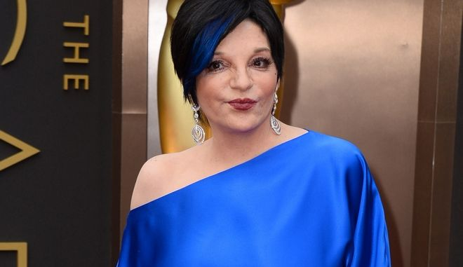 FILE - In this March 2, 2014 file photo, Liza Minnelli arrives at the Oscars in Los Angeles.  Minnelli is said to be resting comfortably in a California hospital after undergoing back surgery this week and shes thanking fans for their well wishes. Minnellis back injury had prevented her from performing most of the year or attending the funeral of Joan Rivers in New York this month.  (Photo by Jordan Strauss/Invision/AP)