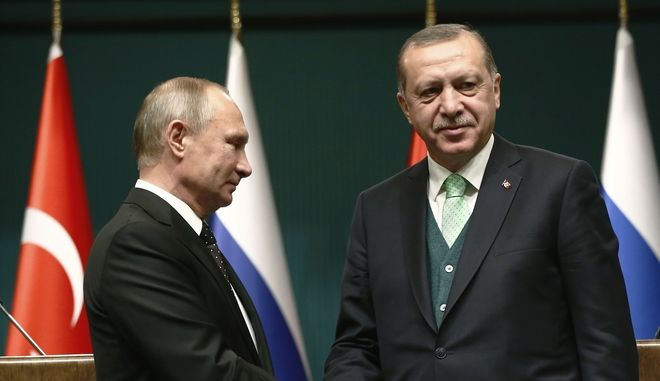 FILE - In this Monday, Dec. 11, 2017 file photo, Turkey's President Recep Tayyip Erdogan, right, shakes hands with Russia's President Vladimir Putin, left, following their joint news statement after their meeting at the Presidential Palace in Ankara, Turkey. NATO-member Turkey has finalized a deal with Moscow to purchase a Russian-made anti-missile system. Under the deal announced by Turkish defense officials on Friday, Dec. 29, 2017. Turkey would buy at least one S-400 surface-to-air missile battery with the option of procuring a second battery. The deal would make Turkey the first NATO member to own Russias most advanced air defense system and, comes amid Ankaras deteriorating relations with the United States and other western countries. (AP Photo/Burhan Ozbilici, File)